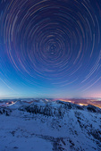 Star trails over the Tenmile Range from the summit of 14,265-foot Quandary Peak, near Breckenridge, Colorado