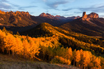 Dunsinane Mountain, Precipice Peak, Redcliff, Coxcomb Peak, Chimney Rock, and Courthouse Mountain from Cimarron Ridge at sunset, San Juan Mountains, Colorado
