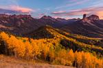 Dunsinane Mountain, Precipice Peak, Redcliff, Coxcomb Peak, Chimney Rock, and Courthouse Mountain from Cimarron Ridge at sunset, San Juan Mountains, Colorado