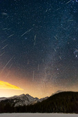 Geminid meteor shower over Longs Peak and Bear Lake, Rocky Mountain National Park, Colorado. This image is a composite of 54 images, shot over an eight-hour period on December 12-13, 2015.