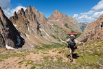 Glenn Randall approaching the saddle between Ruby and Noname Creeks with Pigeon Peak and Turret Peak behind him, Weminuche Wilderness, Colorado