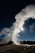Castle Geyser backlit by the full moon, Yellowstone National Park, Wyoming