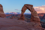 Delicate Arch and the La Sal Mountains at sunset, Arches National Park, Utah