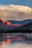 Sunset light on the Fisher Towers reflected in the Colorado River, Utah