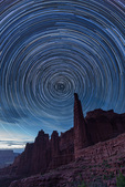 Star trails over the Titan, Fisher Towers, Utah. The land was lit by the last twilight glow to the west.