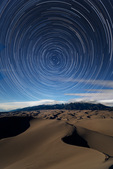 Star trails over the moonlit Sangre de Cristo Range from High Dune, Great Sand Dunes National Park, Colorado