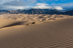 Wind-rippled sand near the summit of High Dune and the Sangre de Cristo Range, Great Sand Dunes National Park, Colorado