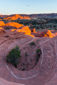Horseshoe-shaped pothole at sunset, Needles District, Canyonlands National Park, Utah