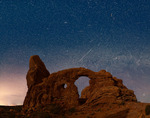 Geminid meteor shower over Turret Arch, Arches National Park, Utah