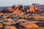 Sunrise light on towers above Elephant Canyon and Junction Butte, Needles District, Canyonlands National Park, Utah