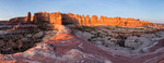 Sunrise glow on towers above Big Spring and East Elephant Canyons, Needles District, Canyonlands National Park, Utah