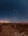 Geminid meteor shower over Monument Basin, Canyonlands National Park, Utah, December 13-14, 2018. This composite image shows 86 meteors captured over an eight and a half hour period.