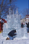 Carving a ice castle sculpture at the Plymouth Ice Festival
