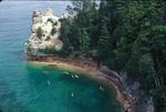 Kayakers on Lake Superior paddling around Miner's Castle