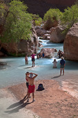 River runners play in the calcium carbonate rich waters of Havasu Creek, near its confluence with the Colorado River in Grand Canyon National Park, Arizona