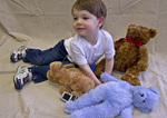 Diabetic Child enjoying his stuffed animals