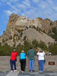 Visitors admiring Mount Rushmore at the visitor's center, South Dekota