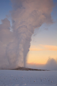 Old Faithful geyser erupting in winter.  Yellowstone National Park, Wyoming.