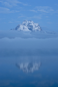 Pre-dawn on Mt. Moran reflected in Jackson Lake in Grand Teton National Park, Wyoming.