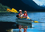 Father-son kayaking in Shag Cove, Geikie Inlet, Glacier Bay National Park, Alaska