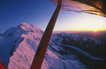 Flying at sunset by Mt. McKinley's north flank, Denali National Park, Alaska