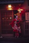A Geisha leaves a restaurant, Gion District, Kyoto, Japan