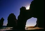 A couple walks through El Arco (The Arch), Cabo San Lucas, Baja California Sur, Mexico