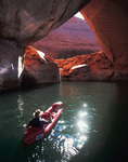 Kayaking below La Gorce Arch in Davis Gulch, Escalante, Lake Powell, Utah
