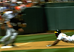 Ricky Henderson steals third base for the Oakland A's, Oakland Coliseum, Oakland, California