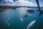 Parasailing by town of Paihia, Bay of Islands, North Island, New Zealand