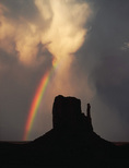 Rainbow and thunderstorm over the West Mitten, Monument Valley, Arizona