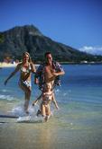 Family play on Waikiki Beach, Honolulu, Oahu, Hawaii