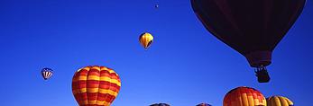 Waving from an ascending balloon, International Balloon Fiesta, Albuquerque, New Mexico