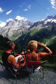 Couple viewing mountains from Obersteinberg Hut, Bernese Oberland, Switzerland