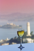 Chardonnay at the Mandarin-Oriental Hotel, Coit Tower and Alcatraz Island in background, San Francisco, California