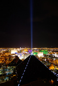 Luxor's laser beam and The Strip, viewed from MIX Restaurant atop THE Hotel at Mandalay Bay, Las Vegas, Nevada