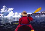Kayaking by iceberg in the Columbia Glacier forebay, Prince William Sound, Alaska