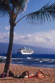 Enjoying the beach, with a cruise ship offshore, Kona, Big Island, Hawaii