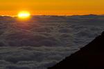 Sunrise over the clouds in December, from the summit of Haleakala, Haleakala National Park, Maui, Hawaii