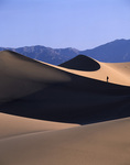 Hiking the dunes at sunrise, near Stovepipe Wells, Death Valley National Park, California