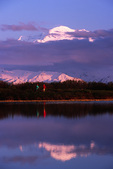 Mountain bikers at Reflection Pond at sunset below Mt. McKinley, 20,320', Denali National Park, Alaska