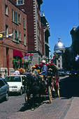 A horse drawn carriage tours Old Montreal, Canada
