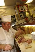 carving up smoked meat sandwiches at Schwartz's, Montreal, Canada