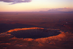 Meteor Crater at sunrise, San Francisco Peaks in the background, Arizona