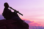 Chief Ray Tsosie plays his flute to the sunset, near Cathedral Canyon, Arizona