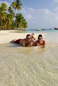 A couple enjoys the perfect beach on Dog Island, San Blas, Panama