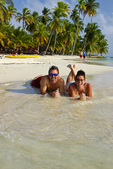 A couple enjoys the perfect beach on Dog Island, San Blas, Panama