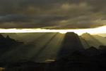 Sun beams illuminate the eastern portion of Grand Canyon National Park after sunrise, from Yavapai Point, Arizona