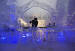A bartender plies his trade at the N'Ice Bar, inside the Ice Hotel, Station Duchesnay, outside Quebec City, Canada