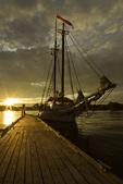 Sunset illuminates the 1886 schooner Issac H. Evans, at dock in Belfast, Maine
